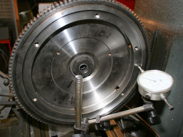 measuring flywheel runout with a dial indicator running on the pressure plate mounting face
